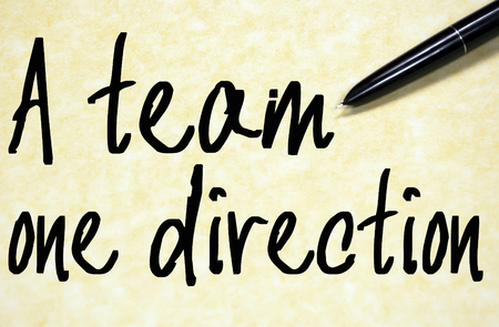 coalesce: a team one direction text write on paper Stock Photo