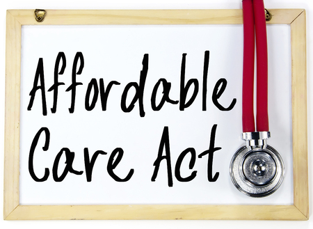 affordable: affordable care act text write on whiteboard