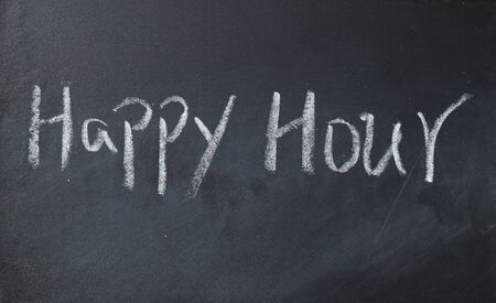 working hour: happy hour text write on blackboard