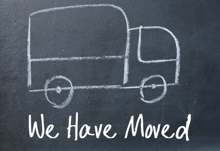 we have moved: we have moved sign on blackboard