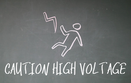 high voltage sign: caution high voltage sign on blackboard