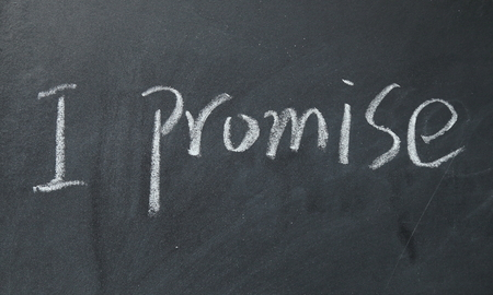 promise: I promise text write on blackboard Stock Photo