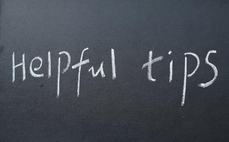 helpful: helpful tips text write on blackboard