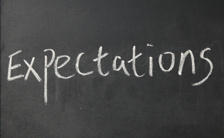 expectations word write on blackboard Stock Photo