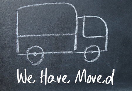 moving office: we have moved sign on blackboard