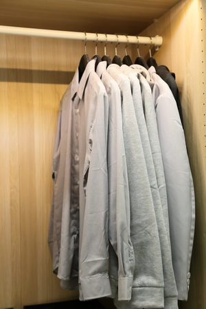 garderobe: A few pieces of mens shirts in cabinet Stock Photo