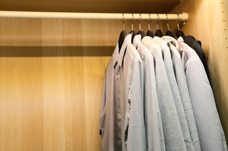 A few pieces of mens shirts in cabinet Stock Photo