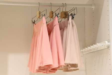 A few pieces of womens casual dress in the closet Stock Photo