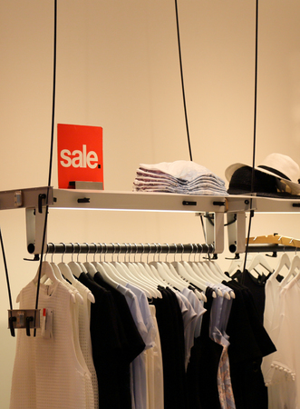 store sign: sale sign at clothing store