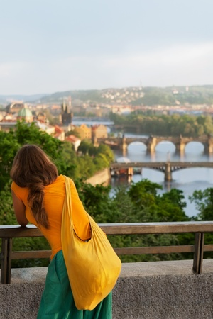 Young woman in bright Indian style clothes travel in Europe  Beautiful city  Prague