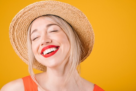 laughing with delight pleasure satisfied smile. Adorable blonde woman in straw hat. Summer mood Stockfoto