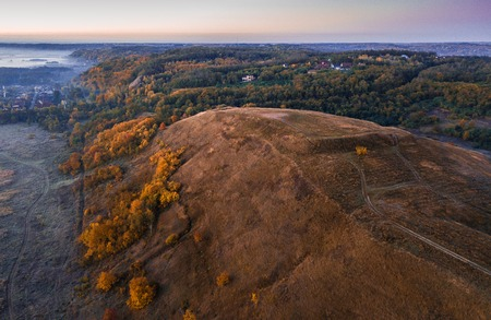Autumn cold morning nature. Hill and valley. Aerial drone photo.
