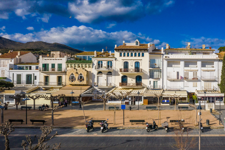 Embankment Central Street in Cadaques Spain. cozy little Cafes and restaurants in white houses. Sunny day photo. Popular tourist destination