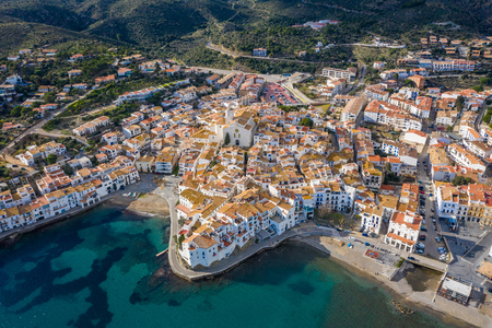 CAdaques Spain. Dali city. aerial top view from above. picturesque linen houses, tiled roofs and a church on the Mediterranean coast Archivio Fotografico