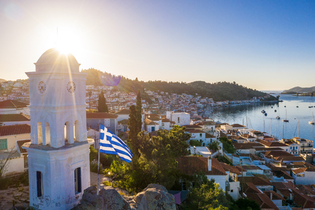 Good morning Greece. Island Poros sunrise sun. patriotic national flag