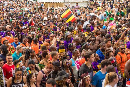 Berlin, Germany - June 9, 2019: Carnival of Cultures Parade Karneval der Kulturen Umzug - a multicultural music festival in Kreuzberg. a crowd of diverse nationalities walking down the street. Patying crowd 新闻类图片