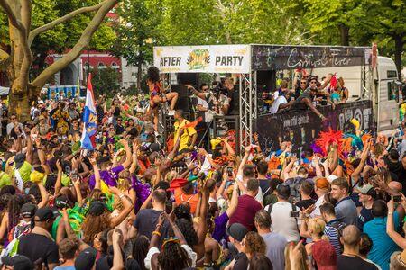 Berlin, Germany - June 9, 2019: Carnival of Cultures Parade Karneval der Kulturen Umzug - a multicultural music festival in Kreuzberg. a crowd of diverse nationalities dancing on street. Truck with music
