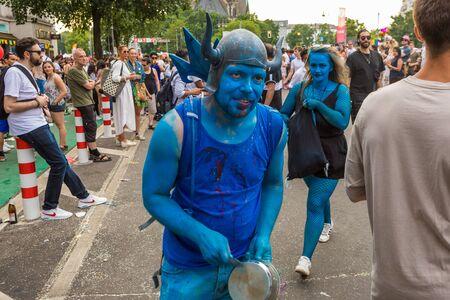 Berlin, Germany - June 9, 2019: Carnival of Cultures Parade Karneval der Kulturen Umzug - a multicultural music festival in Kreuzberg. People colored in blue. Party hard