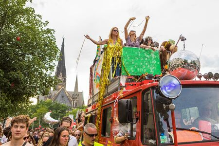 Berlin, Germany - June 9, 2019: Carnival of Cultures Parade Karneval der Kulturen Umzug - a multicultural music festival in Kreuzberg. Woman on truck performing. kirche am sudstern on the background. equal rights Editorial