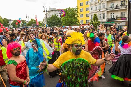Berlin, Germany - June 9, 2019: Carnival of Cultures Parade Karneval der Kulturen Umzug - a multicultural music festival in Kreuzberg. a crowd of diverse nationalities dancing on street. Truck with music. HAppy dancing people. Funny and fancy