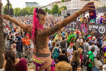 Berlin, Germany - June 9, 2019: Carnival of Cultures Parade (Karneval der Kulturen Umzug) - a multicultural music festival in Kreuzberg. Dancing punk woman in revealing bikini clothes with dreadlocks and tattoos. Summer time in Berlin