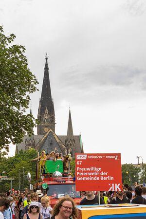 Berlin, Germany - June 9, 2019: Carnival of Cultures Parade Karneval der Kulturen Umzug - a multicultural music festival in Kreuzberg. Woman on truck performing. kirche am sudstern on the background. equal rights 新聞圖片