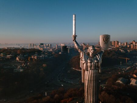 Kiev Ukraine the most popular tourist places to visit The Motherland Monument. Aerial drone photo of huge steel statue of woman with shield and sword