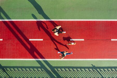Active Sport theme. Runners with dog on green and red. Summer morning active couple. Aerial drone top view