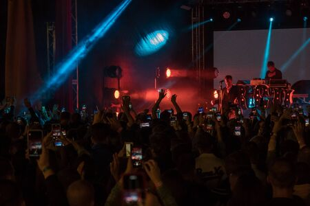 28.06.2019 - Kiev Ukraine. Kuraz bazar event. Gus Gus show Excited crowd at the concert shoots video and photos on mobile phones. 新闻类图片