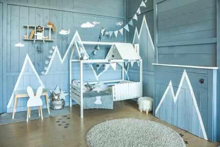 Blue bedroom interior for small pilot boy. Lovely and cozy room for kid. Adventure style decorations 免版税图像