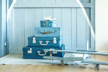 Boy room decoration. Blue Suitcases on the floor in the nursery kids room. Interior for child young pilot. Horizontal composition 免版税图像