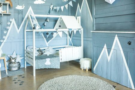 Adventure style Blue bedroom interior for small pilot boy. Lovely and cozy room for kid. Natural light