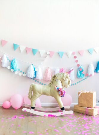 pink kids girly room with horse toy and flowers. Kids interior wall. Vertical composition. Positive vibes. Girls dreams