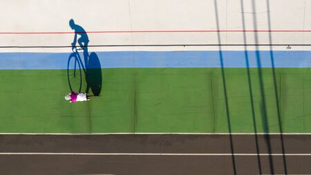Sport cyclist shadow. Reach your goal. Aerial top view photo. preparation for the competition. Leader