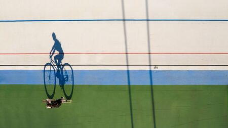 Professional sport aerial top view poster. cyclist on velotrack