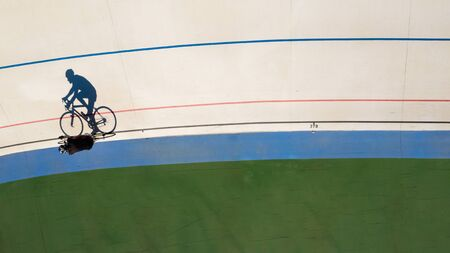 Sport cyclist shadow. Reach your goal. Aerial top view photo