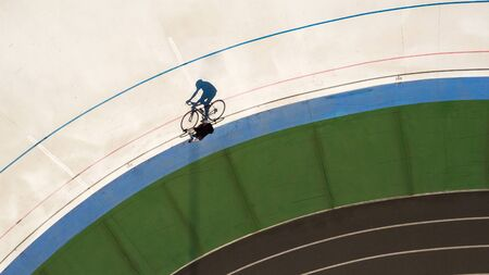 cyclist in training. Top view original shadow shape. Sport poster