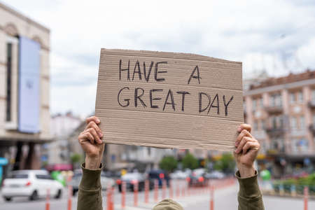 Have a great day card. Happy kind wish. Hand holding sign outside on street. Social public messages on banners outside on streets. reflection phrases self love. support and cheer up