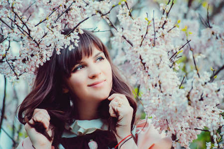 Beautiful girl in a vintage dress. Spring flowers. Victorian style Stock Photo
