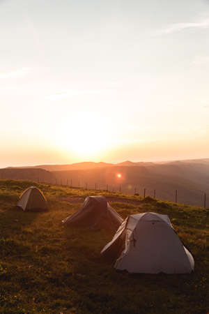 Camping tent in Mountains Morning sunrise Landscape Travel Lifestyle concept adventure vacations outdoor hiking gear equipment Reklamní fotografie