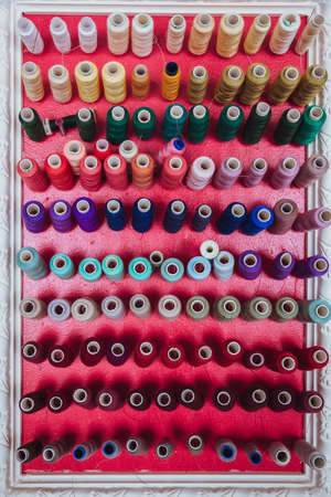 multi color Spools of thread needlework, sewing, tailoring and tailoring concept. Stock Photo - 129048587