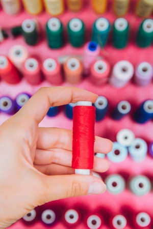 multi color Spools of thread needlework, sewing, tailoring and tailoring concept. Stock Photo - 129048602