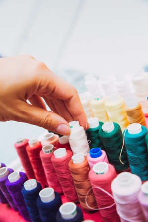 multi color Spools of thread needlework, sewing, tailoring and tailoring concept.
