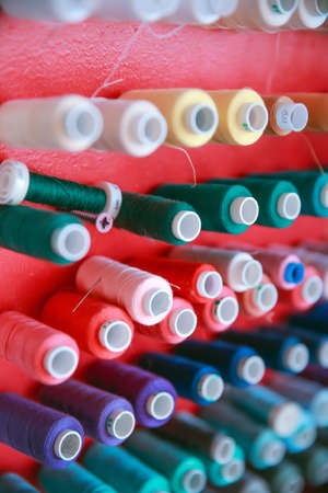 multi color Spools of thread needlework, sewing, tailoring and tailoring concept. Stock Photo - 129048709
