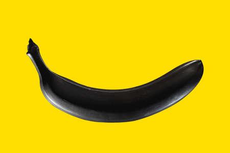 Black banana on a yellow background Pop art Stockfoto