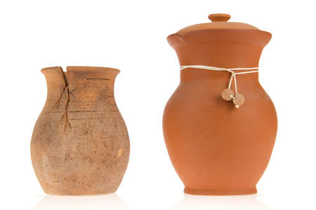 Two ceramic jugs on isolated background photo