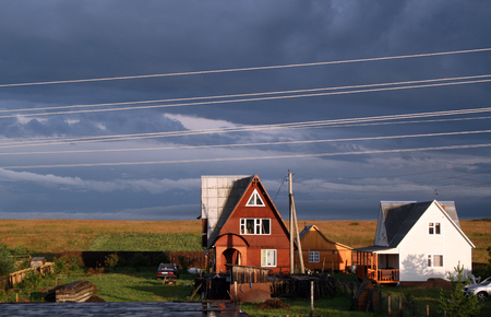 Country cottage at a dawn with a line of external wires photo