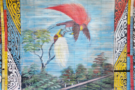 curtain wood  painted natural bird of paradise dancing (cendrawasih) Standard-Bild