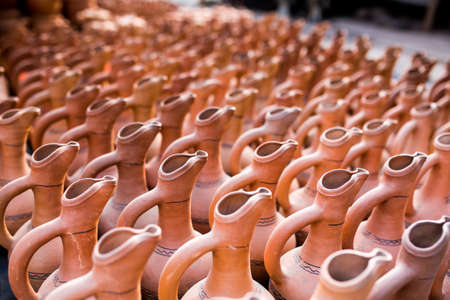 stoneware: pottery, earthenware, clayware, crockery, stoneware.  used for holding and pouring liquids.