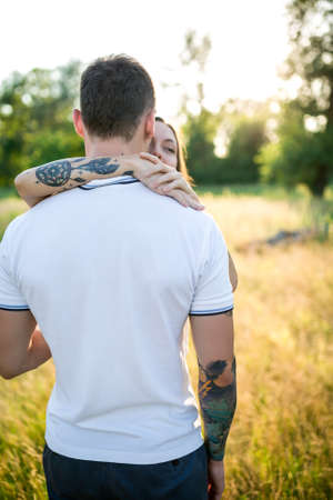 teen love: Couple in love - Beginning of a Love Story. A man and a girl with a tattoo on the nature